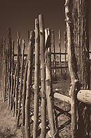 Wood Fence at the Taos Pueblo Entrance. Image taken with a Nikon D800 and 35 mm f/1.4G lens (ISO 100, 35 mm, f/8, 1/1000 sec). Converted to B&W (Sepia) with Nik Silver Efex Pro 2.