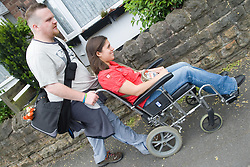 Young woman with Cerebral Palsy in a wheelchair with her boyfriend,
