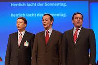 """21 MAR 2004, BERLIN/GERMANY:<br /> Klaus-Uwe Benneter, SPD Generalsekretaer, Franz Muentefering, SPD Parteivorsitzender, und Gerhard Schroeder, SPD, Bundeskanzler, (v.L.n.R.), singen zum Abschluss des Parteitages mit dem Essener Bergwerks-Chor das Partei-Lied """"Wann wir schreiten Seit´ an Seit´"""", außerordentlicher SPD-Bundesparteitag, Estrel Convention Center<br /> IMAGE: 20040321-01-189<br /> KEYWORDS: Parteitag, party congress, Franz Müntefering, Gerhard Schröder"""
