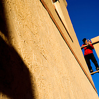 010513       Cable Hoover<br /> <br /> Felix Arthur balances on a support beam to hang a sign on the new Hozho Center in Gallup Saturday.