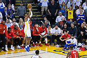 Golden State Warriors guard Patrick McCaw (0) shoots a three pointer against the Houston Rockets at Oracle Arena in Oakland, Calif., on October 17, 2017. (Stan Olszewski/Special to S.F. Examiner)