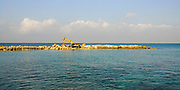 Building a breakwater in the Mediterranean Sea. Photographed in Bat Galim, Haifa, Israel