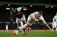 Enner Valencia of West Ham United pushes Jon Flanagan of Liverpool to the ground. The Emirates FA cup, 4th round replay match, West Ham Utd v Liverpool at the Boleyn Ground, Upton Park  in London on Tuesday 9th February 2016.<br /> pic by John Patrick Fletcher, Andrew Orchard sports photography.
