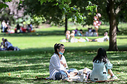 People wearing face surgical masks walk through St James' Park in Central London on Monday, June 22, 2020, meanwhile, some others appear to be enjoying a day of leisure and what it appears to be challenging the two-metre social distancing rule, which will be under review as the UK relax coronavirus lockdown measures that implemented to stem the spread of the virus. The UK's coronavirus death toll has passed more than 40,000, according to the latest government figures. A total of 40,261 people have died in hospitals, care homes and the wider community after testing positive for the virus. (Photo/ Vudi Xhymshiti)