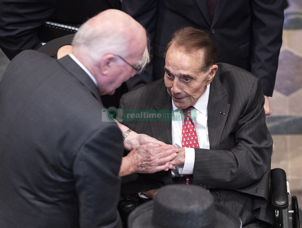 Former United States Senator Bob Dole (Republican of Kansas), right, is welcomed by US Senator Patrick Leahy (Democrat of Vermont) prior to the funeral service for the late US Senator John S. McCain, III (Republican of Arizona) at the Washington National Cathedral in Washington, DC, USA on Saturday, September 1, 2018. Photo by Ron Sachs/CNP/ABACAPRESS.COM