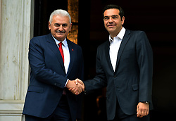 June 19, 2017 - Athens, Greece - Turkish Prime Minister Binali Yildirim, left, shakes hands with Greek Prime Minister Alexis Tsipras during their meeting in Athens. (Credit Image: © Eurokinissi via ZUMA Wire)