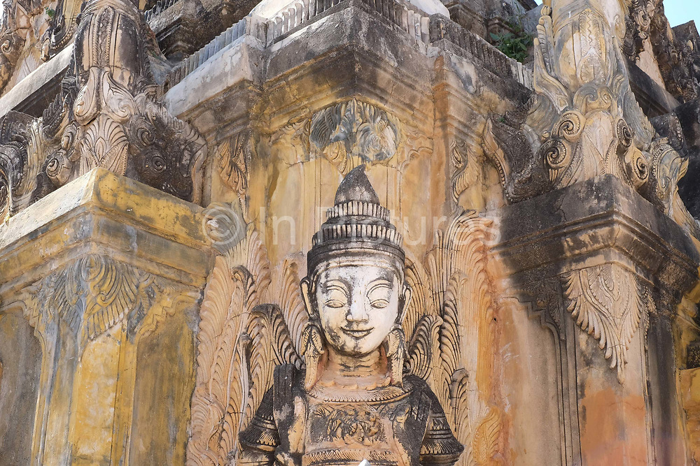 A Buddhist stone statue in the village of Sankar on the edge of Inle Lake on 21 January 2016 in Shan State, Myanmar
