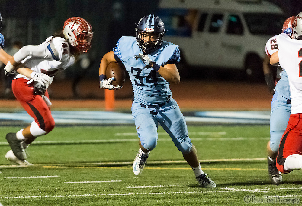 Oakmont High School Vikings Raymond Meza (34), runs with the ball during the first quarter as the Oakmont High School Vikings host the Antelope High School Titans Friday Sep 30, 2016.<br /> photo by Brian Baer
