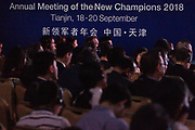 Participants listen during the session: China's Financial Opening at the World Economic Forum - Annual Meeting of the New Champions in Tianjin, People's Republic of China 2018.Copyright by World Economic Forum / Greg Beadle