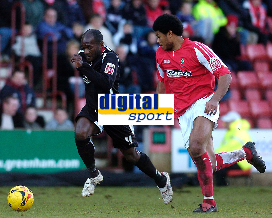 Photo: Alan Crowhurst.<br />Swindon Town v Swansea City. Coca Cola League 1.<br />31/12/2005. <br />Adrian Forbes (L) attacks for Swansea.