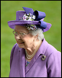 The Queen smiles as she looks at the race programme  in the parade ring. After her horse Estimate wins the Gold Cup at Royal Ascot 2013 Ascot, United Kingdom,<br /> Thursday, 20th June 2013<br /> Picture by Andrew Parsons / i-Images