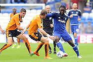 Cardiff City's Kenwyne Jones (r) attacks the Wolves defence. Skybet football league championship match, Cardiff city v Wolverhampton Wanderers at the Cardiff city stadium in Cardiff, South Wales on Saturday 22nd August 2015.<br /> pic by Carl Robertson, Andrew Orchard sports photography.