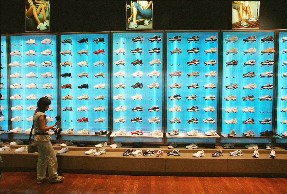 A shopper examines shoes at a mall in Honolulu, Hawaii.