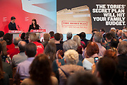 London, UK. Wednesday 29th April 2015. Labour Party Leader Ed Miliband and Shadow Secretary of State for Work and Pensions Rachel Reeves speaks at a General Election 2015 campaign event on the Tory threat to family finances, entitled: The Tories' Secret Plan. Held at the Royal Institute of British Architects.