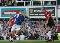 Photo: Lee Earle.<br /> Portsmouth v Manchester United. The Barclays Premiership. 07/04/2007.United's Rio Ferdinand (R) looks frustrated as Portsmouth's Matthew Taylor turns to celebrate scoring their first goal.