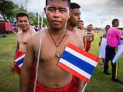 """24 JULY 2014 - BANGKOK, THAILAND:  Students reenact historic Thai battles during a patriotic parade at the happiness party on Sanam Luang. The Thai Junta is organizing a series of public events throughout Thailand meant to bolster public opinion. The events are called """"restoring happiness to the people"""" parties. They feature historic pageants, music, food, health checks and free haircuts. The party in Bangkok is on Sanam Luang, the Royal Parade Ground, which is near the Grand Palace and the Ministry of Defense.   PHOTO BY JACK KURTZ"""