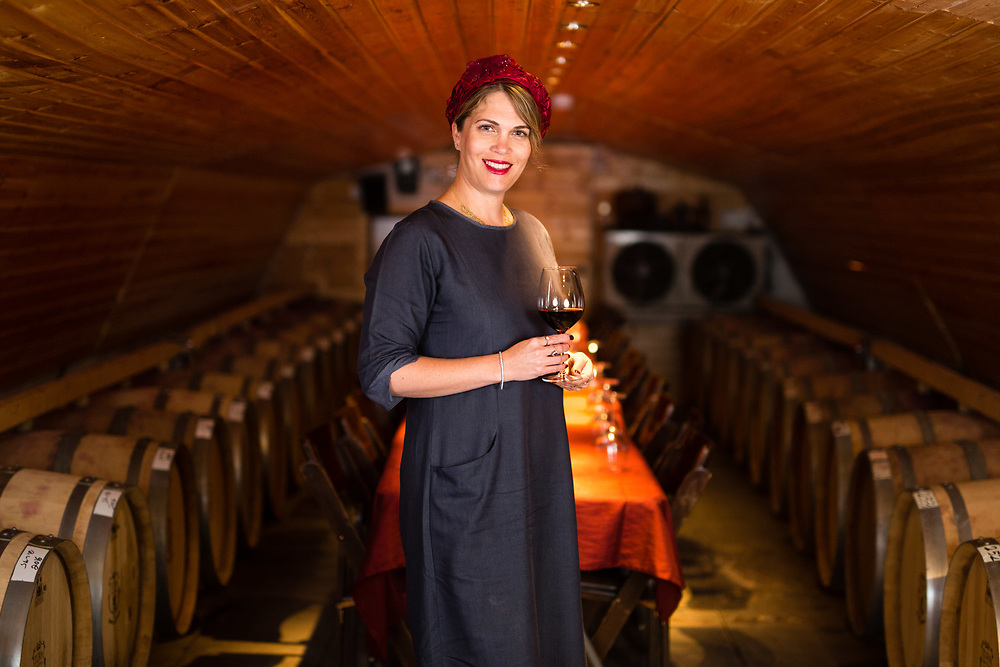 Vered Ben-Sa'adon, owner of Tura Winery poses for a portrait at the winery's visitors center which in part is made out of an old military tent, at the West Bank Jewish settlement of Rechelim, located near the Palestinian West Bank city of Nablus, on May 16, 2017.