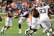 September 05 2009   Illinois QB Juice Williams (7, left of center) hands off to teammate Kaeman Mitchell (29, left) as Illinois OL Corey Lewis (70, at right) blocks Missouri's DL Terrell Resonno (93, far right).  The University of Missouri hosted the University of Illinois in the annual Arch Rivalry Football Game at the Edward Jones Dome in downtown St. Louis on September 5, 2009.  The Mizzou Tigers won, 37-9...            *******EDITORIAL USE ONLY*******