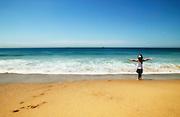 Little girl running at beach