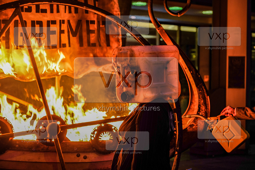 "Protesters wearing pinstripe suits and masks made from salvaged waste oil containers found washed up on a Cornish beach, set fire to a Viking longship which bore a sail reading PARIS CLIMATE AGREEMENT in London, on Sunday, Nov 15, 2020. (VXP Photo/ João Daniel)<br /> <br /> ""We are experiencing cascading marine, geophysical and ecological breakdown. If we don't change our habits now, we will destroy our greatest resource, with unthinkable consequences says a statement on Sunday sent from Ocean Rebellion, an environmental activist group in London. Ocean Rebellion activists are seen in a ceremonial demonstrative activity which they called it as 'Viking Burial of IMO's lack of climate ambition'."