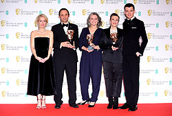 Gillian Anderson and Asa Butterfield pose for a photo with Mark Jenkin, Linn Waite and Kate Byers after presenting them with their award for Best Outstanding Debut by a British Writer, Director or Producer in the press room at the 73rd British Academy Film Awards held at the Royal Albert Hall, London.