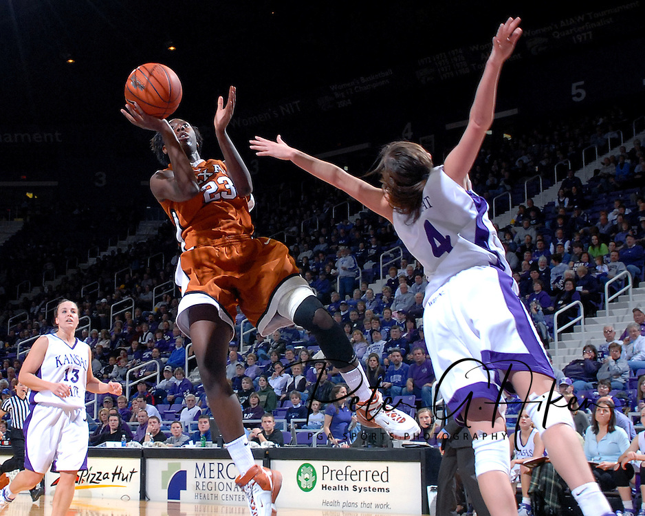Texas forward Nigky Hughes (23) puts up a shot past pressure from Kansas State's Ashley Sweat (4), during the first half at Bramlage Coliseum in Manhattan, Kansas, February 3, 2007.  Texas leads the Wildcats at halftime 27-14.