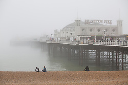 © Licensed to London News Pictures. 16/03/2017. Brighton, UK. A thick layer of fog hangs over the Brighton Palace Pier and Brighton beach. Photo credit: Hugo Michiels/LNP