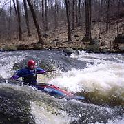 Whitewater kayaker in the Millers River, Massachusetts.