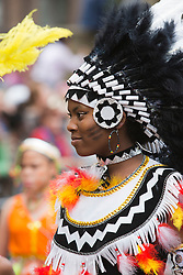 © Licensed to London News Pictures. 27/08/2012 London, England. Pictured: performers from Phoenix Carnival Costume Band. Notting Hill Carnival 2012, the largest street festival in Europe, gets its parade on Adults' Day under way. Photo credit: Bettina Strenske/LNP