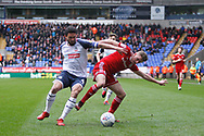Bolton Wanderers Jason Lowe in action with Joe Pritchard of Accrington during the EFL Sky Bet League 1 match between Bolton Wanderers and Accrington Stanley at the University of  Bolton Stadium, Bolton, England on 29 February 2020.