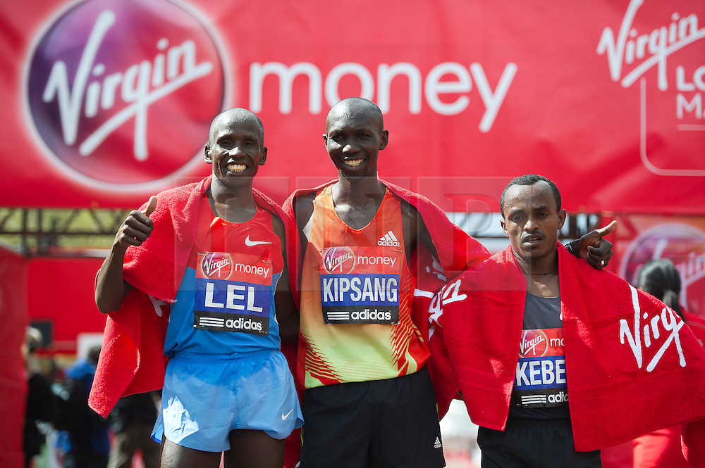 © London News Pictures. 22/04/2012. London, UK.  (L to R) Martin Lel (second Place), Wilson Kipsang (1st place) and Tsegaye Kebede (third place) pose after the Virgin London Marathon 2012 on April 22, 2012 in London, England. Photo credit : Ben Cawthra /LNP