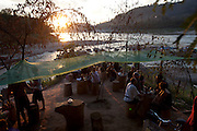 Sunset bar across the bamboo bridge on the Nam Khan River in Luang Prabang, Laos.