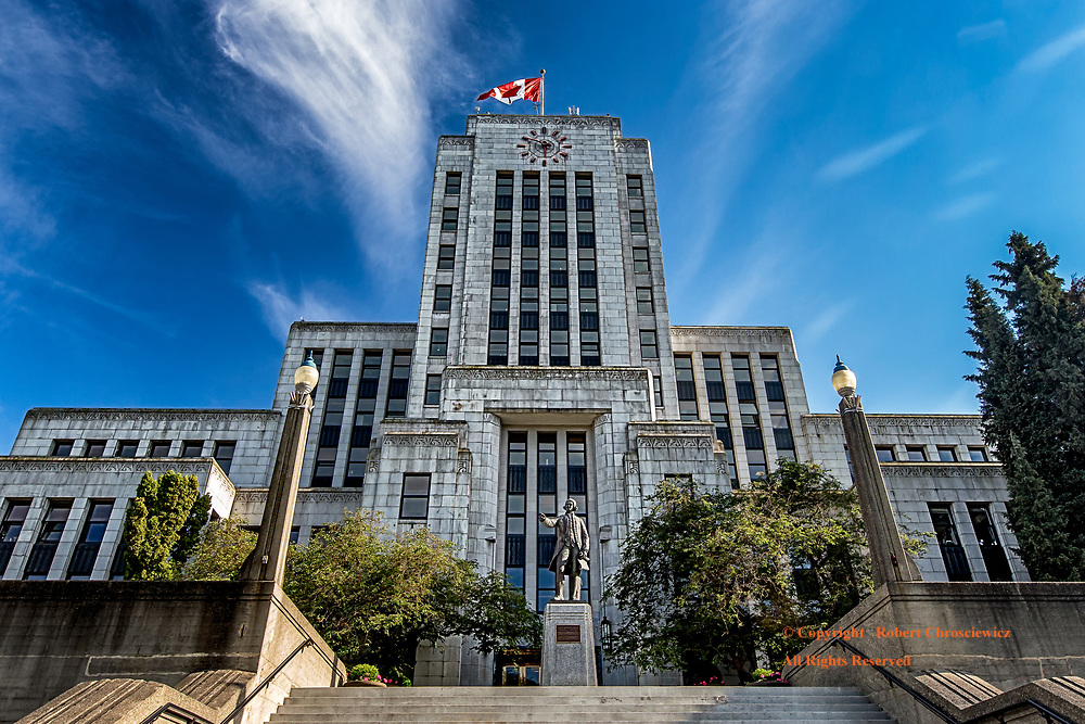 City Hall, Vancouver: A series of stairs leads one up to a statue of the English explorer, Captain George Vancouver, that proudly stands before City Hall, Vancouver British Columbia Canada.