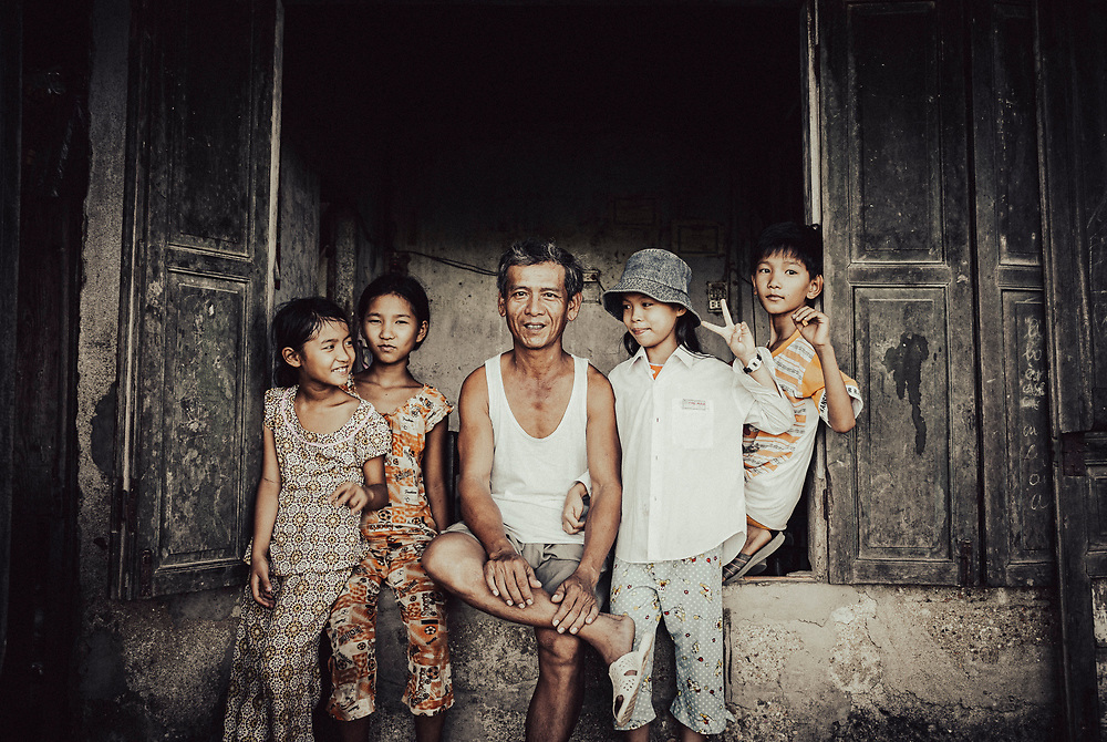 Hue, Vietnam - July 17, 2007: Family and friends pose for a portrait in a village near, Hue, Vietnam.