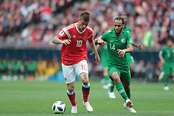 June 14, 2018 - Moscow, U.S. - MOSCOW, RUSSIA - JUNE 14: Midfielder Fedor Smolov of Russia and midfielder Abdullah Otayf of Saudi Arabia during a Group A 2018 FIFA World Cup soccer match between Russia and Saudi Arabia on June 14, 2018, at the Luzhniki Stadium in Moscow, Russia. (Photo by Anatoliy Medved/Icon Sportswire) (Credit Image: © Anatoliy Medved/Icon SMI via ZUMA Press)