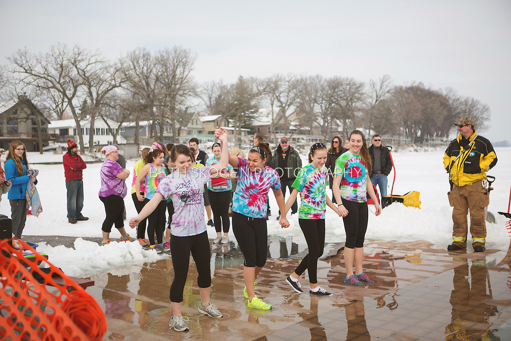 The Oregon Marching Arts program hosts the Wisconsin Winter Plunge fundraiser at Christy's Landing in Madison, Wisconsin on February 7, 2015.