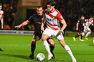 John Marquis of Doncaster Rovers (9) holds up the ball from Lee Cattermole of Sunderland (6) during the EFL Sky Bet League 1 match between Doncaster Rovers and Sunderland at the Keepmoat Stadium, Doncaster, England on 23 October 2018.