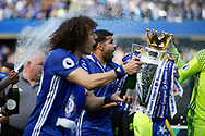 Chelsea Forward Diego Costa (19) and Chelsea Defender David Luiz (30) celebrates with the trophy during the Premier League match between Chelsea and Sunderland at Stamford Bridge, London, England on 21 May 2017. Photo by Andy Walter.