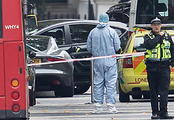 © Licensed to London News Pictures. 07/10/2017. London, UK. A police forensics officers stands infront of a vehicle thought to have been driven into pedestrians in an incident is seen outside the Natural History Museum. Early reports say a man has been arrested after pedestrians injured. Photo credit: Peter Macdiarmid/LNP