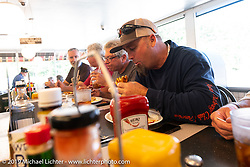 Rodney Sterling having lunch at a Waffle House during the Cross Country Chase motorcycle endurance run from Sault Sainte Marie, MI to Key West, FL. (for vintage bikes from 1930-1948). Stage-6 from Chattanooga, TN to Macon, GA USA covered 258 miles. Wednesday, September 11, 2019. Photography ©2019 Michael Lichter.
