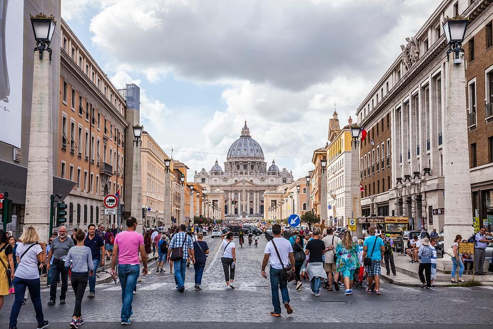 Looking down Via della Conciliazione towards St. Peter's Basilica and square, Rome, Italy, Vatican City.