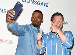 LAS VEGAS, NV - APRIL 26: Otto Bathurst and Jamie Foxx at the Lionsgate CinemaCon 2018 Red Carpet Event at The Colosseum at Caesars Palace in Las Vegas, Nevada on April 26, 2018. 26 Apr 2018 Pictured: Jamie Foxx and Taron Egerton. Photo credit: DAM/MPI/Capital Pictures / MEGA TheMegaAgency.com +1 888 505 6342
