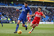 Sean Morrison of Cardiff city (l) gets to the ball ahead of Rudy Gestede of Middlesbrough. EFL Skybet championship match, Cardiff city v Middlesbrough at the Cardiff city Stadium in Cardiff, South Wales on Saturday 17th February 2018.<br /> pic by Andrew Orchard, Andrew Orchard sports photography.