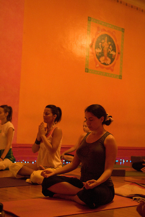 """New York, New York:  The Laughing Lotus, located on 19th st in Manhattan, hosts """"Midnight Yoga"""" sessions Friday nights. Classes begin at 10 pm and Yogians power through the class, which lasts two hours till  midnight. The classes are taught by Marydanna Abbott while Paul Kagianaris drums sweet beats.                            Photos by Tiffany L. Clark"""