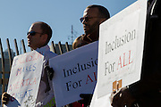 Men hold signs at a protest march and rally organised by the Alliance for an Inclusive America group against the perceived anti-Muslim and anti-foreigner immigration policies of President Donald Trump, Shibuya, Tokyo, Japan. Sunday February 12th 2017. The Alliance of an Inclusive America is a multi-faith non-partisan group. About 250 Americans, other ex-pats and japanese people took part in the march to show people around the world they reject the Executive Order President Trump enacted at the end of January, indefinitely suspending the resettlement of Syrian refugees and temporarily banning people from seven majority Muslim countries from entering the United States.