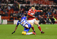 Nottingham Forest forward Joe Lolley (23) battles with Reading's Omar Richards (50) during the EFL Sky Bet Championship match between Nottingham Forest and Reading at the City Ground, Nottingham, England on 20 February 2018. Picture by Jon Hobley.