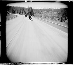 Heading South on Highway 85. Black Hills, SD. 1999<br /> <br /> Limited Edition Print from an edition of 50. Photo ©1999 Michael Lichter.<br /> <br /> The Story: Sunday morning, heading through the hills for the last ride of the week.  It's brisk out as you climb, the cool morning air energizing.  South of Deadwood, the road opens up into sweeping curves and you rock back and forth, accelerating out of each turn.  Moving forward, you know where you are going, but at the same time, you are lost in the wonderful journey.