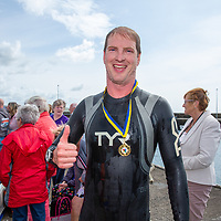 2nd place Adrian Cosgrove from Ennis arriving in Liscannor at the Annual Pat Conway and friends Charity Swim from Lahinch to Liscannor Pier in aid of the Burren Chernobyl Project