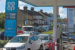© Licensed to London News Pictures 27/09/2021.<br /> Swanley, UK, Motorists block the road queuing. Chaos at this Co-op petrol station in Swanley, Kent. This station had a delivery at 7.30 am this morning and at 2.30pm started to run out of diesel. Fuel panic buying continues today on forecourts up and down the UK as hoarders run petrol stations dry. Photo credit:Grant Falvey/LNP