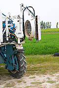 A vineyard tractor equipped for spraying sulphur and other treatments on the vines at the experimental vineyard of the CIVC at Plumecoq near Chouilly in the Cote des Blancs It is used for testing clones soil treatment vine treatments spraying, Champagne, Marne, Ardennes, France